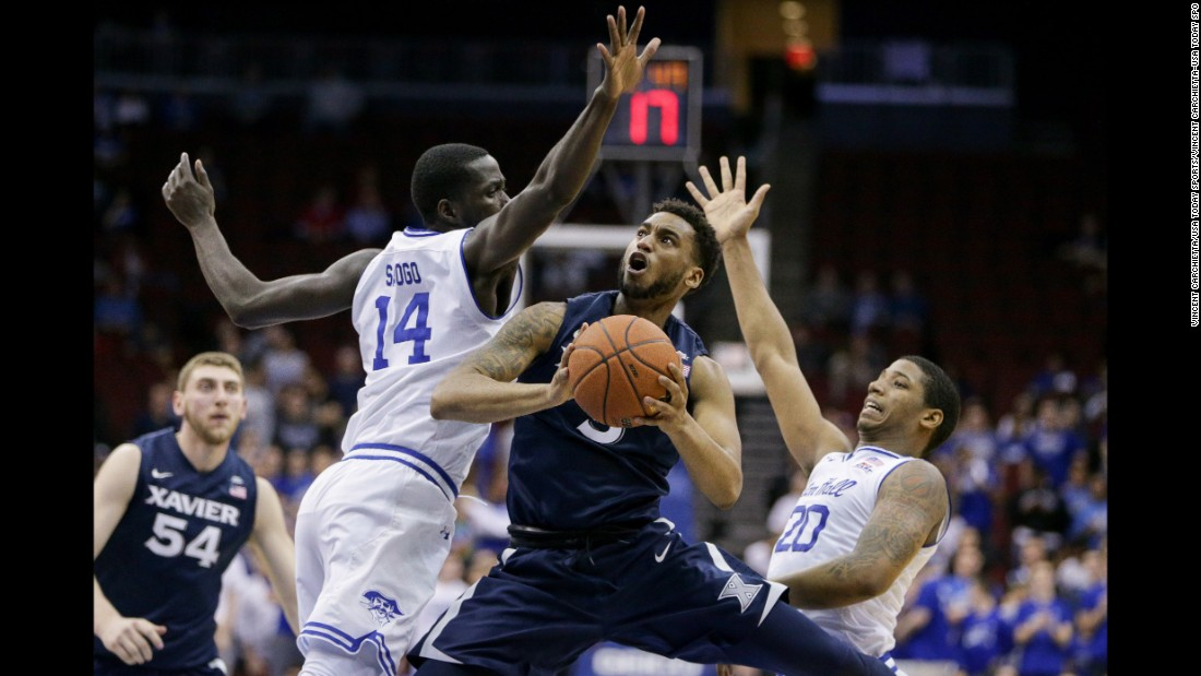 Xavier guard Trevon Bluiett tries to evade Seton Hall defenders during a Big East basketball game in Newark, New Jersey, on Wednesday, February 22.
