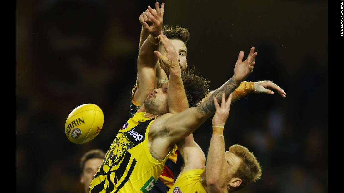 Players collide during an Australian Football League match between the Richmond Tigers and the Adelaide Crows on Friday, February 24.