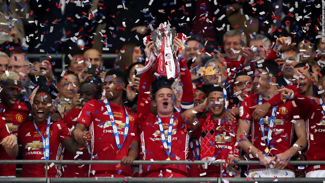 Manchester United captain Wayne Rooney lifts the EFL Cup after a 3-2 victory over Southampton on Sunday, February 26. The annual competition involves the 92 clubs in England's soccer pyramid.