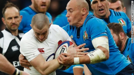 England's full-back Mike Brown is tackled by Italy's number 8 Sergio Parisse (R) during the Six Nations international rugby union match between England and Italy at Twickenham stadium in southwest London on February 26, 2017. / AFP / Adrian DENNIS        (Photo credit should read ADRIAN DENNIS/AFP/Getty Images)