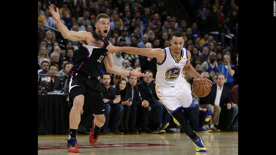 Golden State's Stephen Curry drives past Los Angeles Clippers forward Blake Griffin during an NBA game in Oakland, California, on Thursday, February 23.