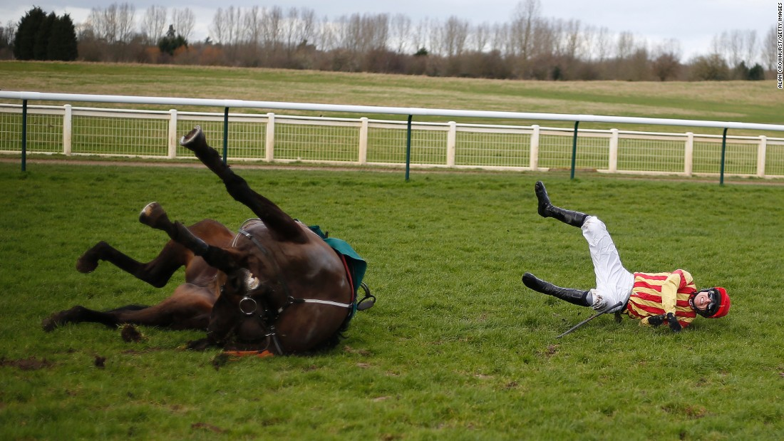 Paddy Brennan and his horse, Global Stage, fall at the last obstacle during a race in Warwick, England, on Friday, February 24.
