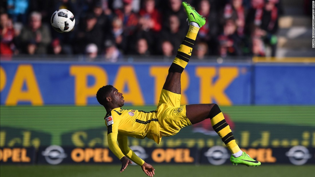 Dortmund's Ousmane Dembele performs an overhead kick during a German league match against Freiburg on Saturday, February 25.
