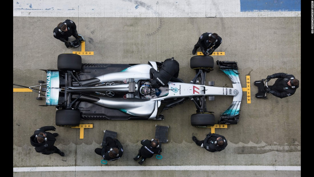 "An overhead view shows Formula One driver Valtteri Bottas and <a href=""http://www.cnn.com/2017/02/24/motorsport/lewis-hamilton-valterri-bottas-mercedes-f1/index.html"" target=""_blank"">Mercedes' 2017 car</a> on Thursday, February 23. Bottas is replacing Nico Rosberg, who retired after winning last season's title."