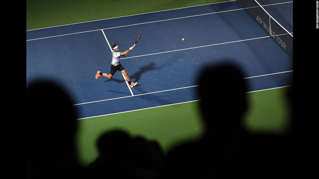 Roger Federer plays a forehand Monday, February 27, during a match in Dubai, United Arab Emirates.