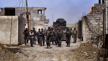 Members of the Iraqi federal police patrol Mosul during an operation to retake the city from ISIS.