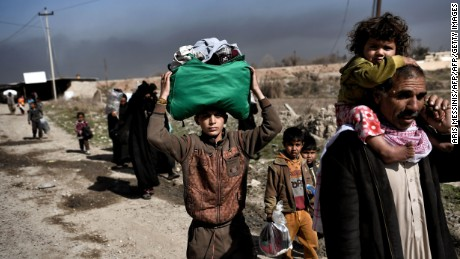 Displaced Iraqis flee the city of Mosul during an operation to retake the city from ISIS.