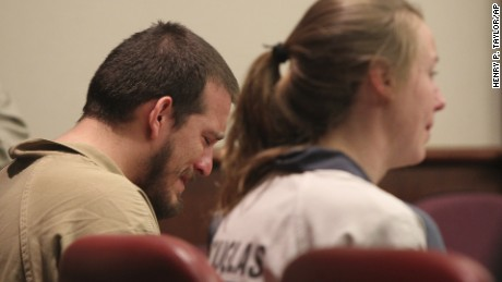 Jose Torres, left, and Kayla Norton, right   at the Douglas County Courthouse in Douglasville, Georgia, Monday, February 27.