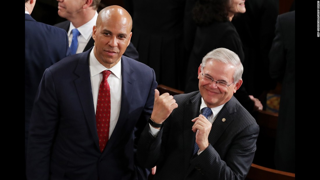 US Sens. Cory Booker and Bob Menendez arrive in the House chamber.