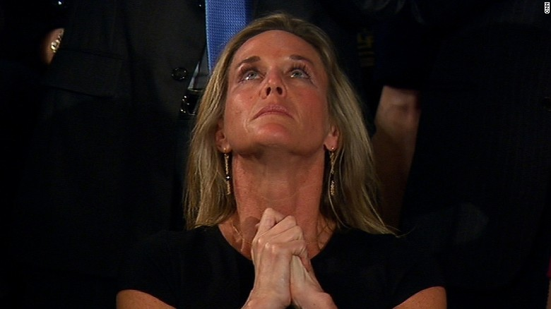 Congress reaction brings SEAL's widow to tears