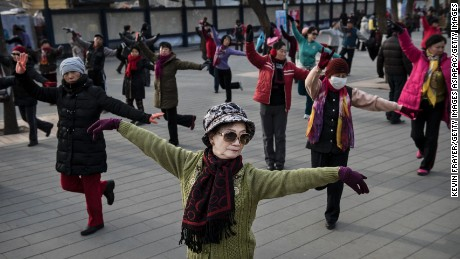 Chinese women dance as they exercise at a public park on December 21, 2014 in Beijing.