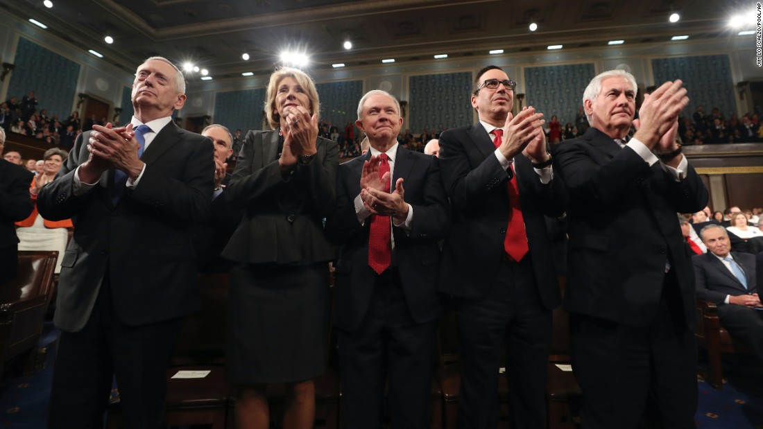 Members of Trump's Cabinet applaud the President. From left are Defense Secretary James Mattis, Education Secretary Betsy DeVos, Attorney General Jeff Sessions, Treasury Secretary Steve Mnuchin and Secretary of State Rex Tillerson.