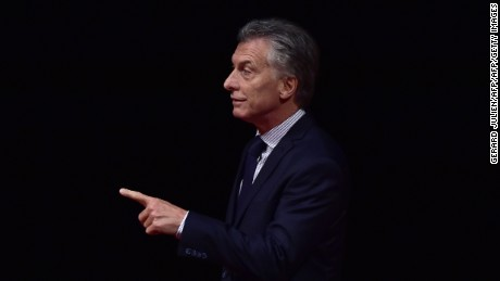 "Argentina's President Mauricio Macri gestures before receiving  receiving the Nueva Economia Forum prize for debating during an award ceremony at the Teatro Real in Madrid on February 24, 2017. Argentinian President Mauricio Macri, on a four day official visit to Spain, called for Spanish companies to invest in his country, where there is a new stage of ""macroeconomic stability and clear rules of the game"". / AFP / GERARD JULIEN        (Photo credit should read GERARD JULIEN/AFP/Getty Images)"
