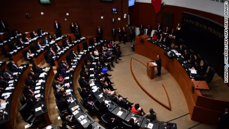 French President Francois Hollande (C) delivers a speech at the Senate in Mexico City, on April 10, 2014. The presidents of France and Mexico kick-started relations between their nations on Thursday, putting behind past strains caused by the case of a Frenchwoman accused of kidnapping. The two countries will sign 30 agreements during the visit in fields ranging from aerospace to energy, security and education. AFP PHOTO/ RONALDO SCHEMIDT        (Photo credit should read RONALDO SCHEMIDT/AFP/Getty Images)
