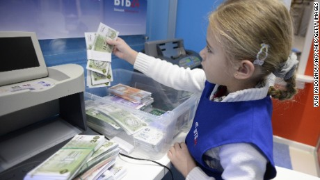 A girl plays in an area representing a bank office at the Central Children's Store at Moscow's Lubyanka square. The store re-opens after nearly seven years of renovation. AFP PHOTO / YURI KADOBNOV        (Photo credit should read YURI KADOBNOV/AFP/Getty Images)