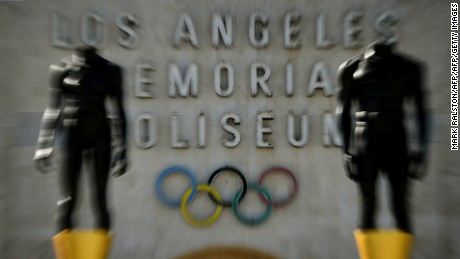An Olympic themed monument stands beside the Los Angeles Memorial Coliseum after rival Budapest dropped its bid for the 2024 Olympics, in Los Angeles, California on February 22, 2017. Budapest has became the latest city to drop out of the race to host the 2024 Olympic Games, after a petition garnered enough signatures to force a referendum on their bid.  / AFP / Mark RALSTON        (Photo credit should read MARK RALSTON/AFP/Getty Images)