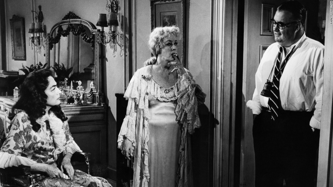 "Crawford approached director Robert Aldrich, right, about teaming her with Davis in the ""Sunset Boulevard""-type story of two show-biz sisters trapped in a decaying Hollywood mansion -- one crippled emotionally, the other in a wheelchair.  ""Baby Jane"" became a sleeper hit when released in the fall of 1962.  It revitalized the careers of Davis and Crawford and created a Hollywood genre in the '60s: schlocky horror films starring aging actresses."