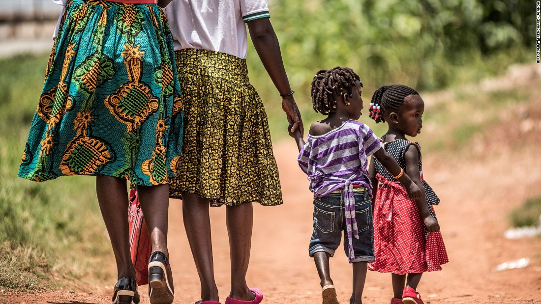 Clients walk home after a visit to the clinic. Over one in ten women of reproductive age in Uganda die during childbirth, according to International Planned Parenthood Federation.