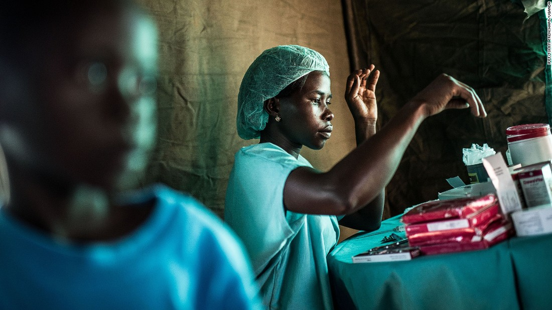 A nurse dispenses drugs during a  RHU mobile clinic expedition to the village of Ochaga, Uganda.