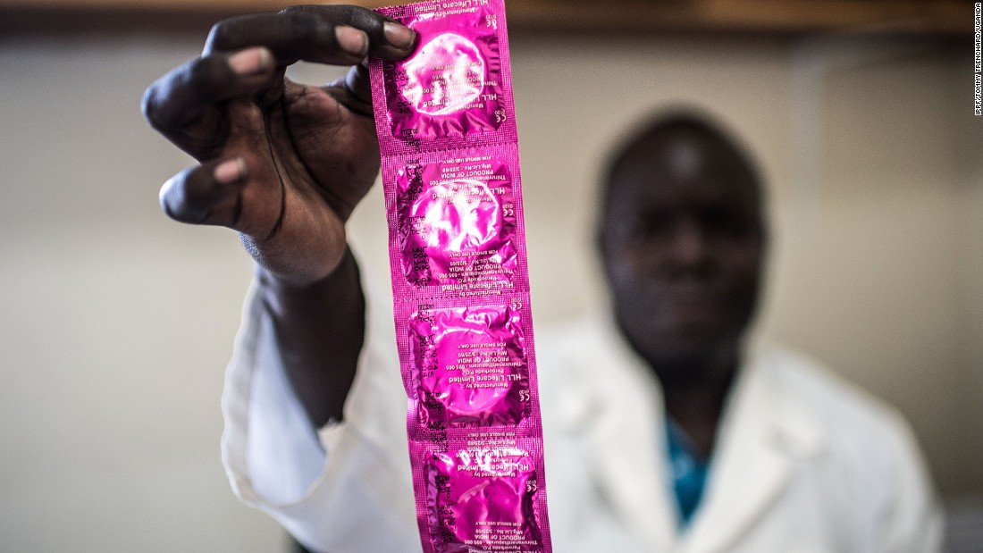 Service provider, Cristopher Okuru, displays a string of condoms at a RHU clinic in Gulu. Currently, only 30% of sexually active Ugandan adolescents have access to contraceptives, according to RHU.