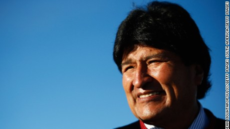 UYUNI, BOLIVIA - JANUARY 11:  Bolivian President, Evo Morales Ayma watches the action during day 8 of the Dakar Rallly on the Salar de Uyuni or Uyuni Salt Flats on January 11, 2015 in Uyuni, Bolivia.  (Photo by Dean Mouhtaropoulos/Getty Images)