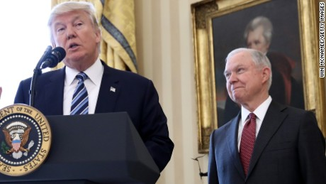 WASHINGTON, DC - FEBRUARY 09:  U.S. President Donald Trump (C) delivers remarks before the swearing in ceremony for Sen. Jeff Sessions (R) in the Oval Office of the White House February 9, 2017 in Washington, DC. Trump also signed three executive orders immediately after the swearing in ceremony. Also pictured is U.S. Vice President Mike Pence (L).  (Photo by Win McNamee/Getty Images)
