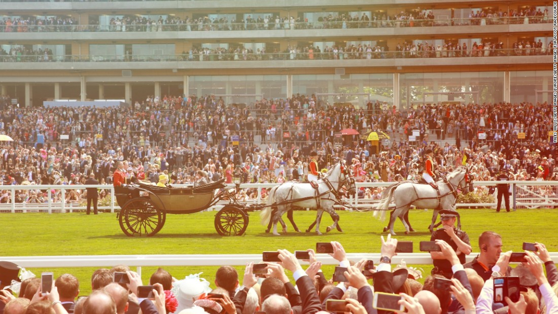 Queen Elizabeth's horse-drawn carriage makes its way down Ascot's straight mile.