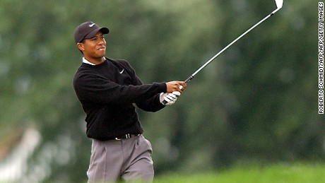 CHASKA, UNITED STATES:  Tiger Woods of the US watches his bunker shot on the 18th hole drop into the cup to finish his suspended second round of 2002 PGA championship 17 August 2002 at Hazeltine National Golf Club in Chaska, Minnesota. Woods finished the round with a 69 for a two-day total of four under par.    AFP PHOTO Roberto SCHMIDT (Photo credit should read ROBERTO SCHMIDT/AFP/Getty Images)