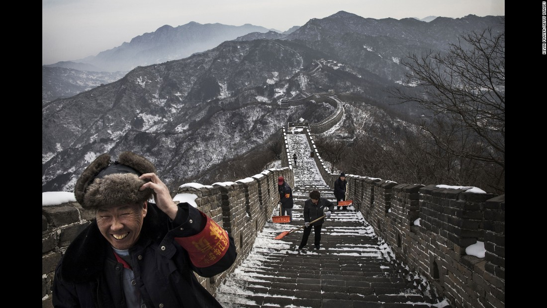 Workers shovel snow off the Mutianyu section of the Great Wall of China on Wednesday, February 22.