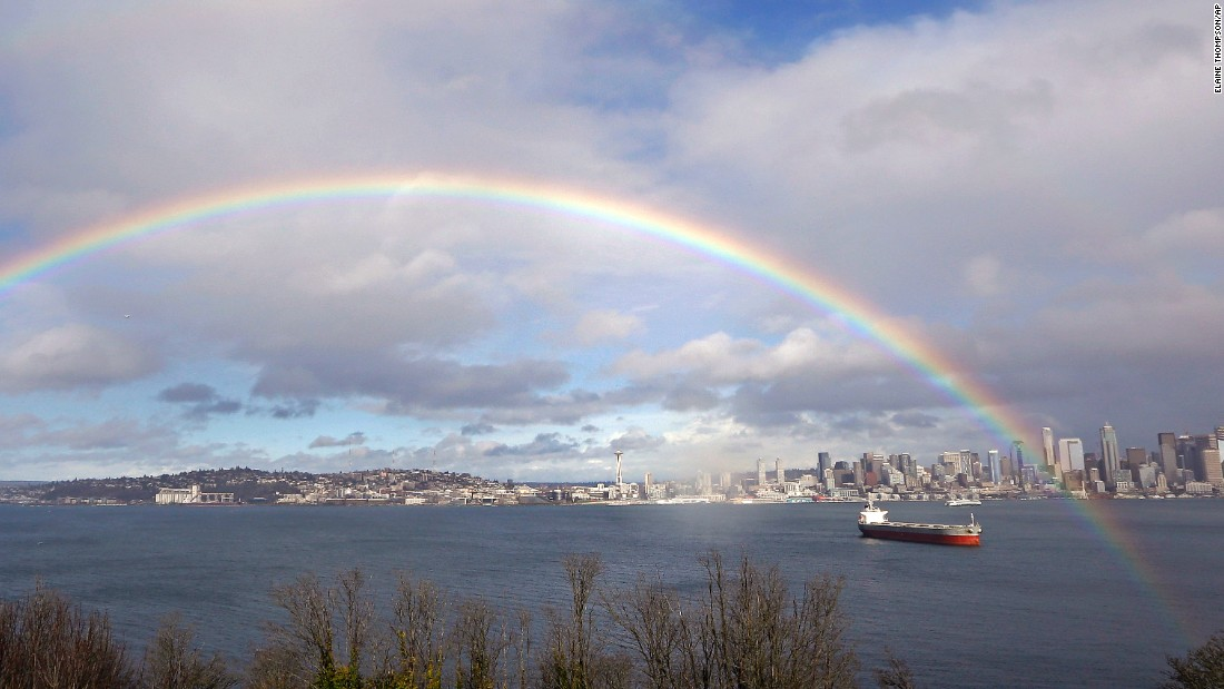 A rainbow appears near Elliott Bay and downtown Seattle on Thursday, February 9.