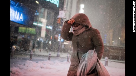 A woman braces against the wind-blown snow in Times Square during the early hours of a winter storm in New York, U.S., February 9, 2017. Mark Kauzlarich for CNN