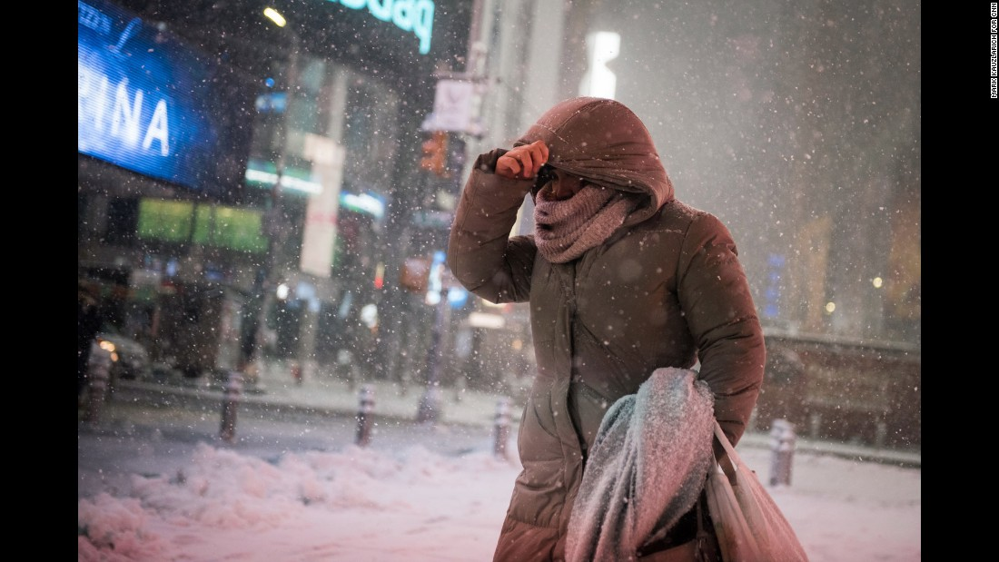 A woman braces against the wind-blown snow in New York's Times Square on Thursday, February 9.