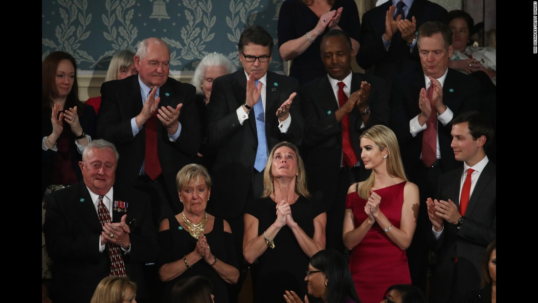 "An emotional Carryn Owens, center, looks up as <a href=""http://www.cnn.com/2017/02/28/politics/navy-seal-widow-trump-address/"" target=""_blank"">she is applauded during President Trump's address</a> to Congress on Tuesday, February 28. Owens' husband, Navy SEAL William ""Ryan"" Owens, recently was killed during a mission in Yemen. ""Ryan died as he lived: a warrior and a hero, battling against terrorism and securing our nation,"" Trump said. The applause lasted over a minute, which Trump said must be a record."