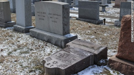 Vandalized stones are scattered at Stone Road or Waad Hakolel Cemetery in Rochester, New York on March 3, 2017. Vandals tumbled and defaced headstones at a Jewish cemetery in a Rochester, New York, local officials confirmed Friday, the third such cemetery in the United States to suffer damage in a surge in apparent anti-Semitic acts. Meredith Dragon, chief executive of the Jewish Federation of Greater Rochester, said local police were not yet ready to determine whether the toppling of a dozen or more headstones in the Stone Road or Waad Hakolel Cemetery overnight March 1, 2017 was an act of petty vandalism or a targeted hate crime. But New York Governor Andrew Cuomo announced an investigation into the rise in crimes and threats against Jewish organizations in the state.  / AFP PHOTO / Gretchen STUMME        (Photo credit should read GRETCHEN STUMME/AFP/Getty Images)