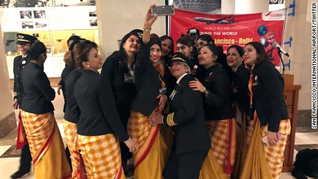 An all-female Air India crew takes a selfie in the San Francisco airport during their record-setting trip.
