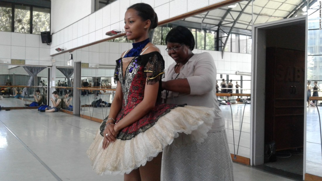 Ballerina Monika Cristina and head seamstress  Evancina Mokwebo during a costume fitting in Johannesburg. <br /><br />Given the expense lavished on ballet costumes, they are often reused for a production for many years and adjusted to fit individual dancers.