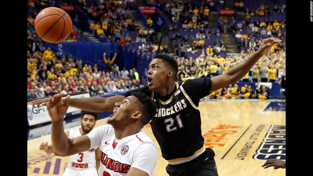 Wichita State's Darral Willis Jr. (No. 21) competes for a rebound with Illinois State's DJ Clayton during the championship game of the Missouri Valley Conference on Sunday, March 5. Wichita State won 71-51 to claim the conference's automatic spot in the NCAA Tournament.