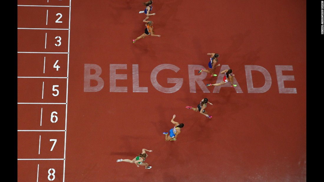 Sprinters cross the finish line of a 60-meter race at the European Indoor Championships on Friday, March 3.