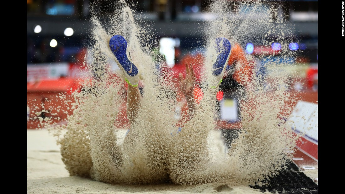 Italian long jumper Filippo Randazzo lands in the pit Friday, March 3, at the European Indoor Championships.