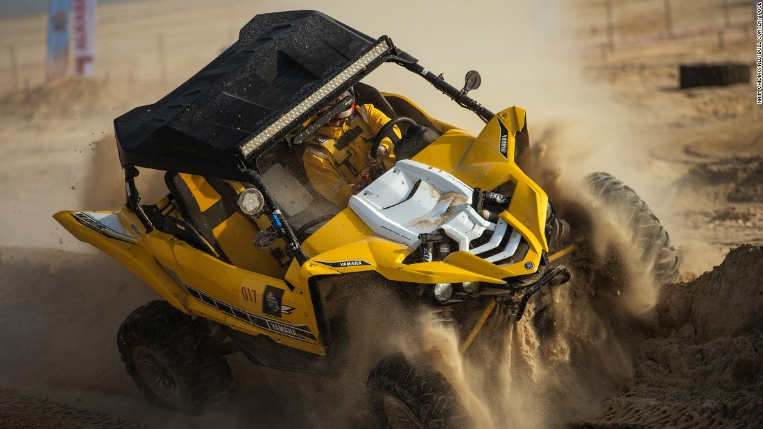 A driver competes in a dune buggy race in Qatar's Sealine Desert on Friday, March 3.