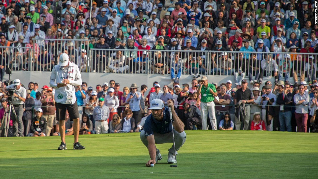 "Dustin Johnson lines up a putt on the last hole of the WGC-Mexico Championship on Sunday, March 5. Johnson, the world's No. 1 player, <a href=""http://www.cnn.com/2017/03/06/golf/dustin-johnson-wgc-mexico-championships/index.html"" target=""_blank"">won the tournament</a> by a stroke."