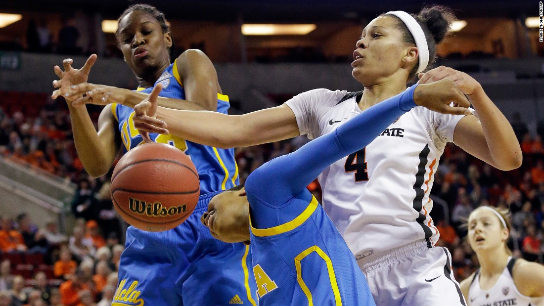 Oregon State's Breanna Brown, right, vies for a loose ball with UCLA's Kennedy Burke, left, and Kelli Hayes during a Pac-12 Tournament game on Saturday, March 4.
