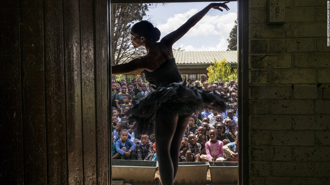 Using ballet and dance to promote healthy and positive choices, in 2014, it provided lecture demonstrations to twenty schools in Soweto, raising awareness and informing students of the available free classes they provide together with the provincial department of education.  <br /><br />Pictured: Senior soloist Kitty Phetla performs in a classroom at the Nka-Thuto Primary School in Soweto.