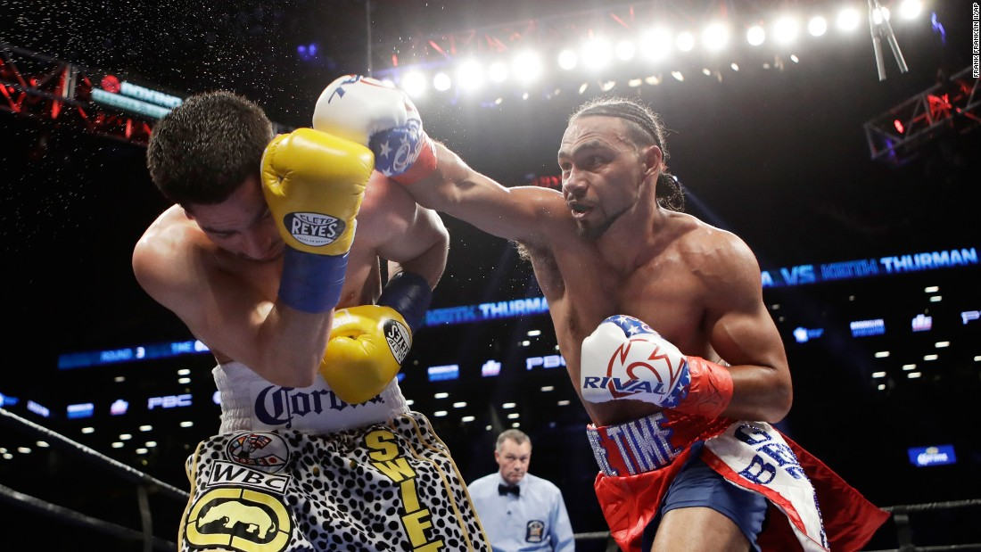 Keith Thurman punches Danny Garcia during their welterweight title fight in New York on Saturday, March 4. Thurman won by split decision.