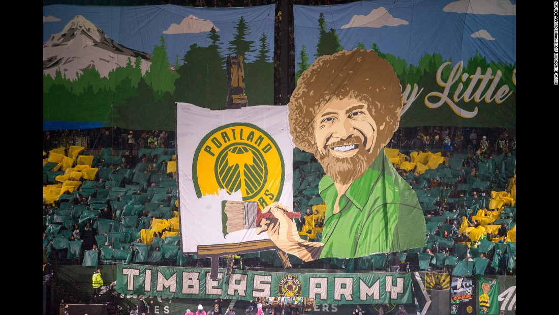"Fans of the Portland Timbers unveil a tifo of famous painter Bob Ross before the MLS season opener on Friday, March 3. The theme was ""Happy Little Trees"" -- Ross' catchphrase and a play on the soccer team's name."