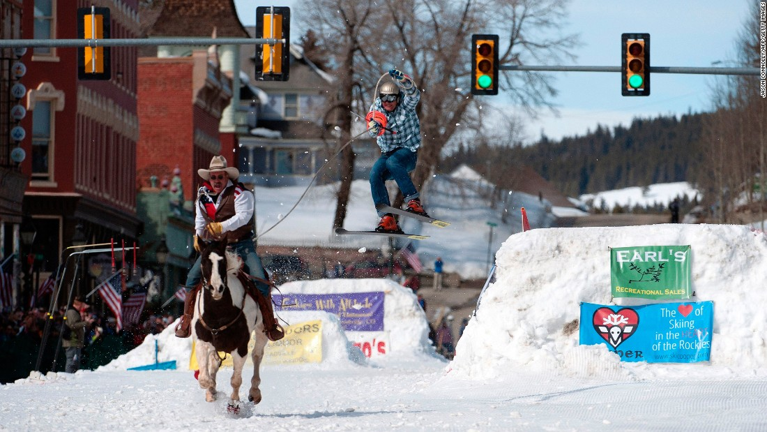 Jeff Dahl rides a horse to pull his son, Greg, during a skijoring competition in Leadville, Colorado, on Saturday, March 4. In skijoring, a skier navigates jumps and slalom gates while grabbing rings for points. Leadville has been hosting skijoring competitions since 1949.