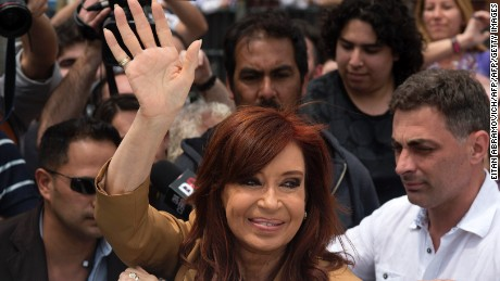 Argentinian former President Cristina Kirchner waves upon her arrival for a hearing in court for alleged fraud in the concession of public works during her term in Buenos Aires on October 31, 2016.   / AFP / EITAN ABRAMOVICH /          (Photo credit should read EITAN ABRAMOVICH/AFP/Getty Images)
