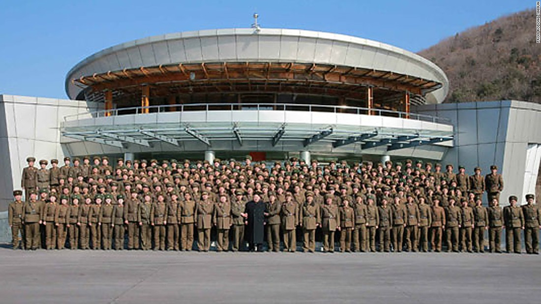 North Korean leader Kim Jong Un (C) stands with troops on March 6, according to state media.