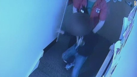 This still from a video shows a daycare worker shoving a 4-year-old girl.