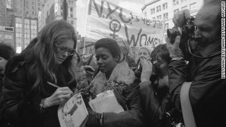 (Original Caption) Rep. Bella Abzug, (D-N.Y.), feminist Gloria Steinem and Lt. Gov. Maryann Krupsak of New York (L-R) chat with the marchers and newsmen in midtown Manhattan prior to the start of the International Women's Day March. Some 2,000 women from all walks of life joined the solidarity march in which they demanded full economic political, legal, sexual and racial equality and the right to control their own lives and bodies.